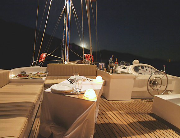 Evenings dining al fresco on board overlooking the sea at night